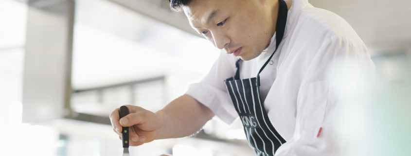 Chef at Harbourside restaurant in Auckland, plating up some Ora King Salmon