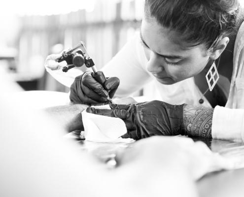Matiah Koloamatangi of Small Axe Studio - tattoo artist
